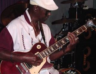 Texas Johnny Brown playing guitar at The Big Easy